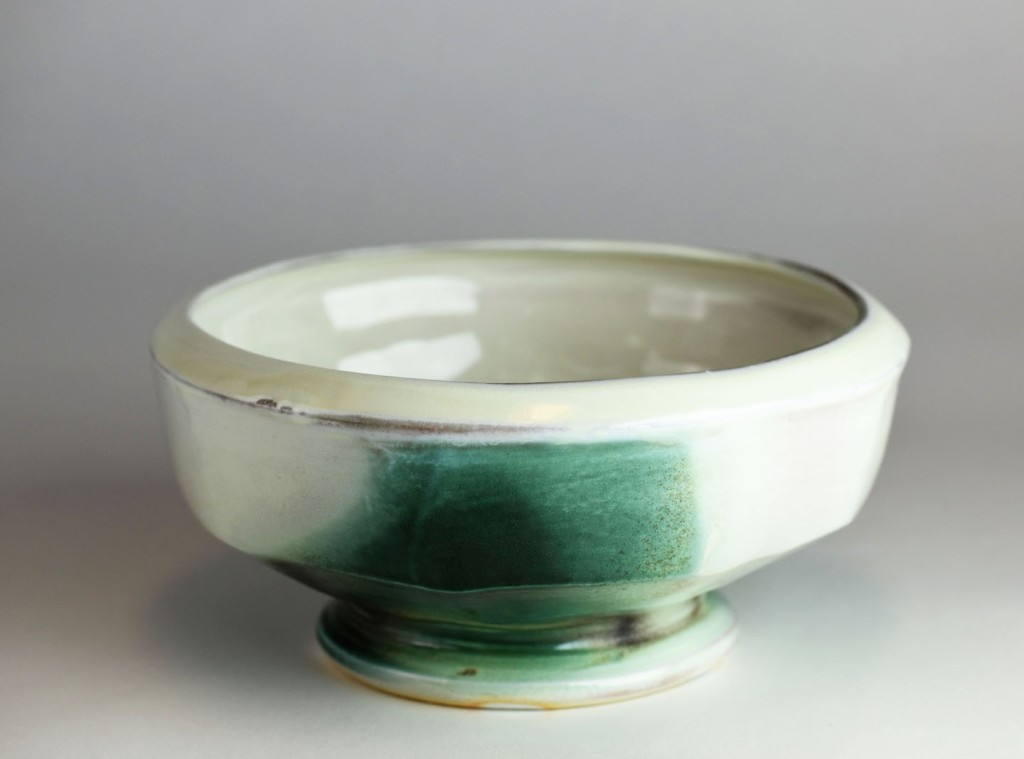 White ceramic service bowl with green accent.