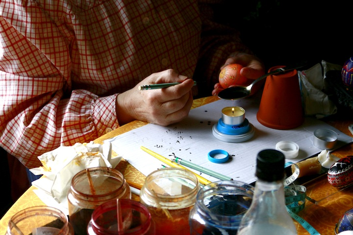 Artist painting Ukrainian eggs.